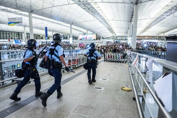 The mayhem came hours after a mass protest forced the airport to suspend check-ins for the second day in a row.