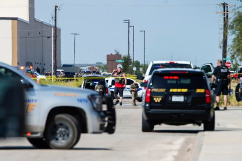 Law enforcement officials surrounding the area behind the Cinergy Odessa entertainment complex in Odessa, Tex., where the suspect was confronted by the police and was killed.