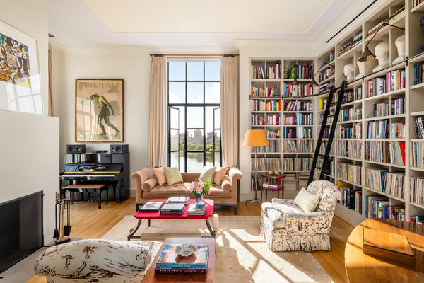 At the top of the triplex is a library/music room, which features built-in shelves that house a sizable collection of vinyl record albums.