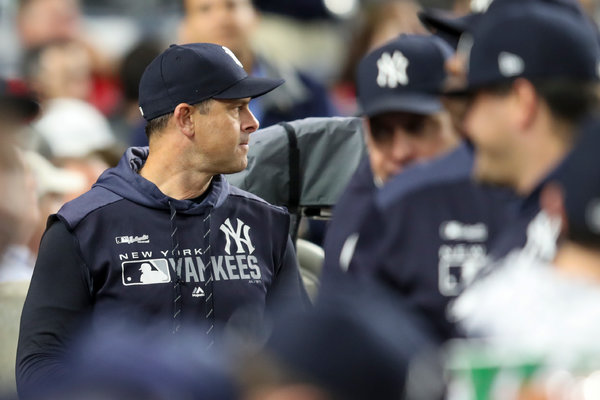 "Yankees Manager Aaron Boone, left, said he had heard ""whispers"" of an M.L.B. investigation before Thursday."