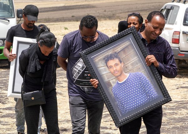 Relatives of Yared Getachew, a 29-year-old pilot who was the captain of Ethiopian Airlines Flight 302, at the crash site in March.