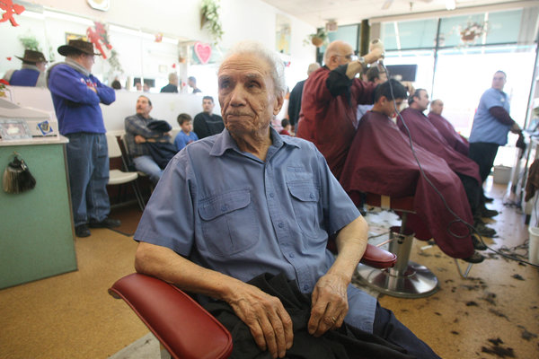 """Mr. Mancinelli in 2010. """"The longer he kept working, the more famous he got,"""" said Jane Dinezza, the owner of Fantastic Cuts, where he last worked."""
