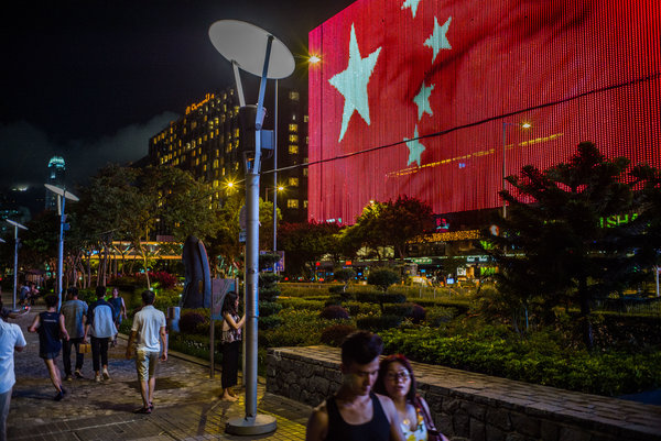 A Chinese national flag on a L.E.D. display in Tsim Sha Tsui, Hong Kong, in 2017.