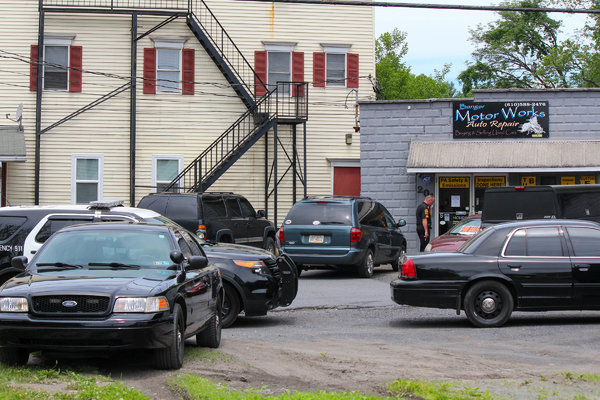 Police officers searched a business in Bangor, Pa., belonging to Jason Muzzicato, who was arrested on suspicion of using a drone to drop bombs near the home of his ex-girlfriend.