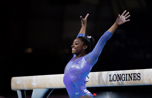 Biles's gold in the balance beam was her 24th career medal at the world championships. She later won the floor exercise, too.