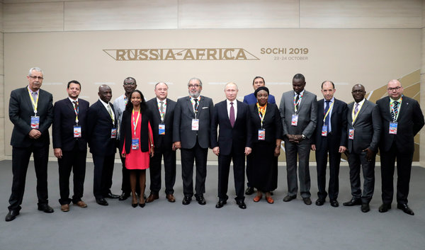 Mr. Putin posed for a photo with the heads of African news agencies on the sideline of the summit.