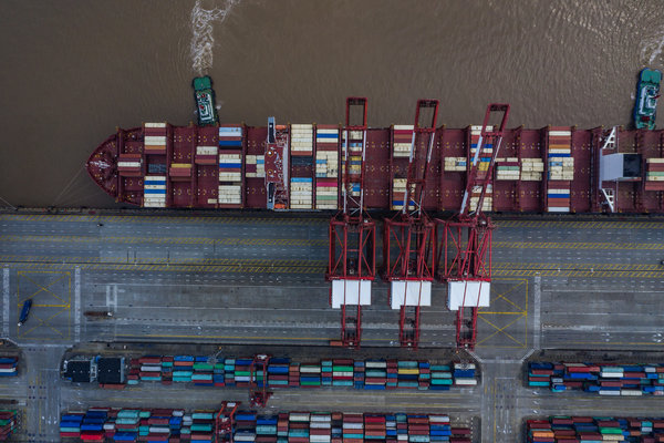 A container ship docked at a port in Shanghai.