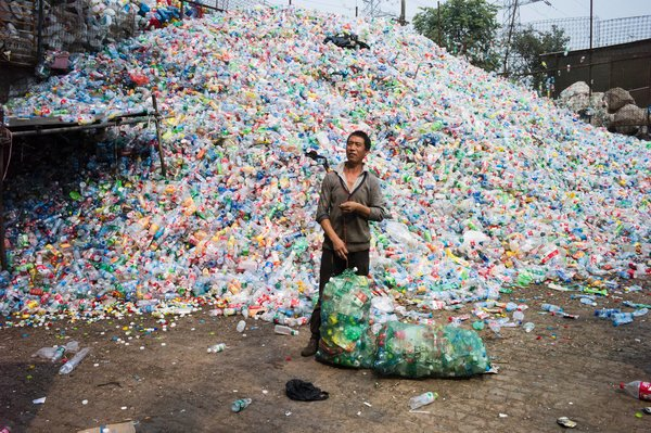 Sorting plastic bottles for recycling on the outskirts of Beijing in 2015.