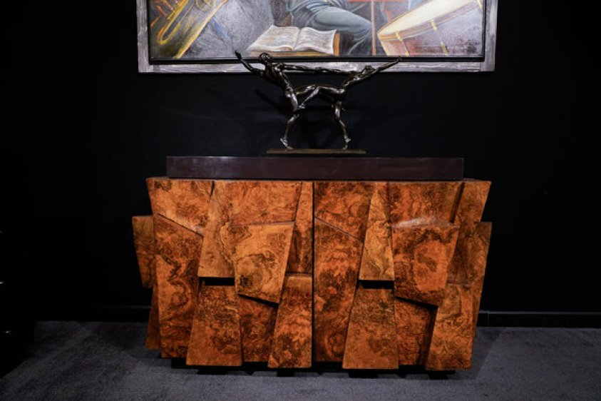 faceted wood cabinet by Paul R. Evans with metal sculpture of dancers on top