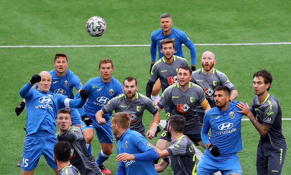 Social distancing was not an option when Isloch (in blue) beat Neman Grodno on Saturday, part of the opening weekend of the soccer season in Belarus.