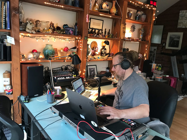 """Matthew Dunn ofWOMR at work in his home on Cape Cod. """"We've had some things taken away from us, but radio is not one of them,"""" he said."""
