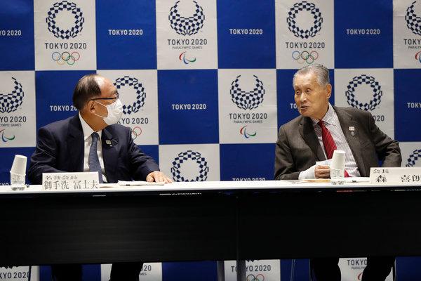 Yoshiro Mori, right, the president of the Tokyo Olympics, and Fujio Mitarai, the honorary president, in Tokyo on Monday.