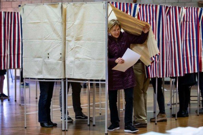 Senator Elizabeth Warren voted in Cambridge, Mass., on Tuesday. Progressive voters in the state split sharply between her and Senator Bernie Sanders.