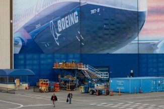 Stock market gains came after  Boeing said it planned to bring about 27,000 employees back to work in Washington State to resume aircraft production.