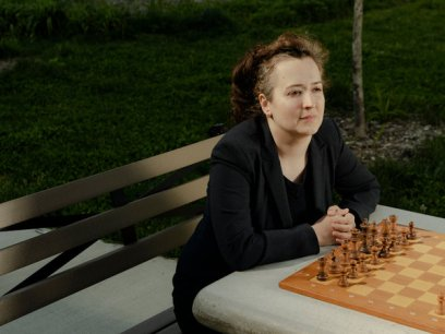 Irina Krush at a chessboard in Asser Levy Park, where she played the game as a child.