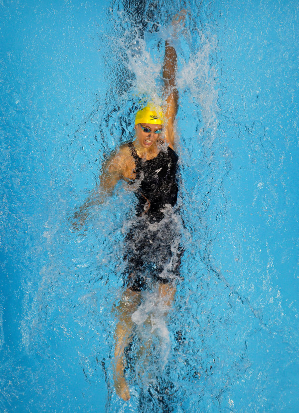 Kathleen Baker, a 2016 Olympian, swimming at a meet in December. Because she has Crohn's disease, Baker started wearing masks on planes long before the coronavirus pandemic began.