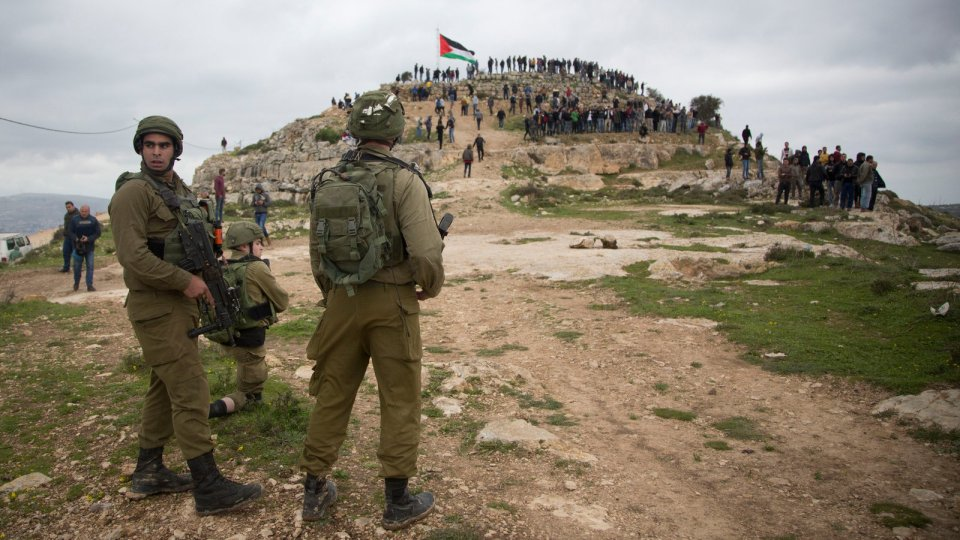 Israeli soldiers standing guard in March at a protest against Israeli settlements in the West Bank.