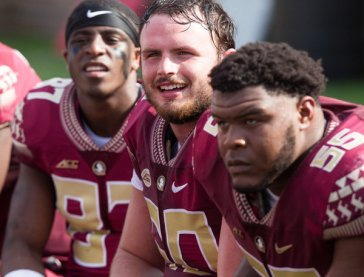 "Florida State lineman Andrew Boselli, center, said the virus made him ""the sickest I've ever felt."""