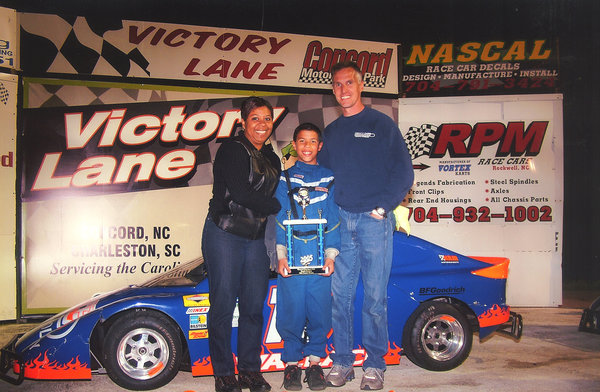 Wallace celebrating a victory with his parents, Desiree and Darrell Sr.