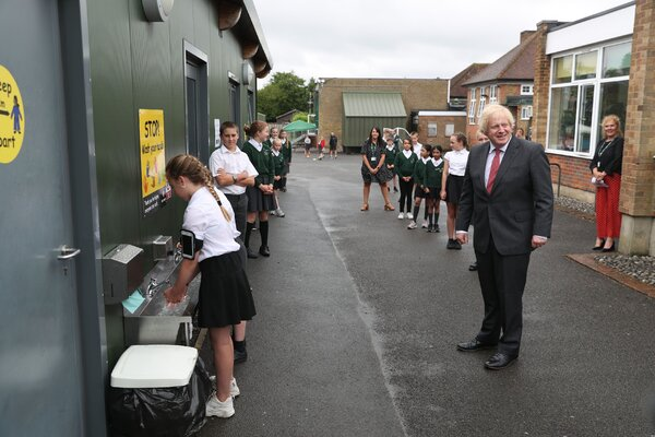Prime Minister Boris Johnson waited to wash his hands during a visit to a school in Bovingdon, England, on Friday.