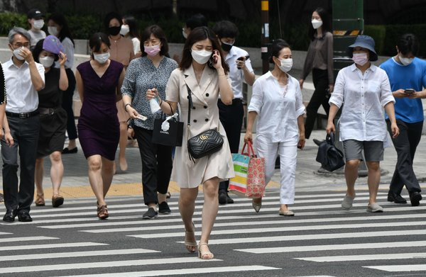 Pedestrians wearing face masks in Seoul, South Korea, on Tuesday.