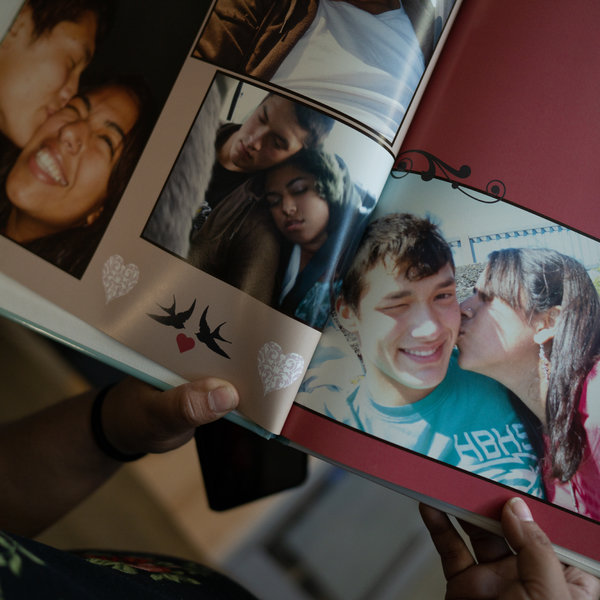 A photo album with pictures of the Trimbles, high school sweethearts who got married in 2012.