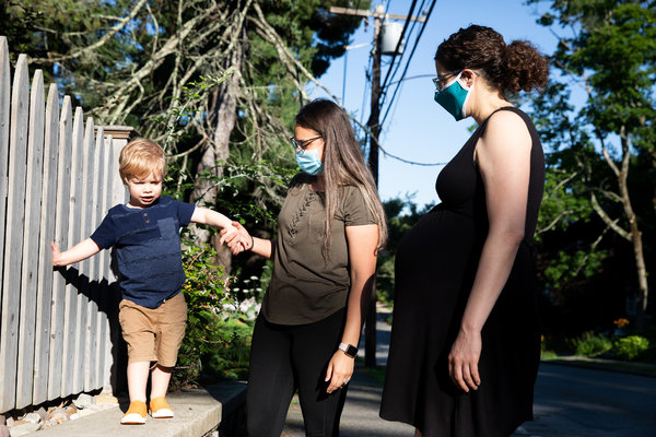 Ana Carolina Rodrigues, center, helping Cole Mattison, 2, alongside his mother, Claudia Mattison. As part of her nanny job, Rodrigues was asked to avoid getting takeout food, limit grocery trips and wear gloves in stores.
