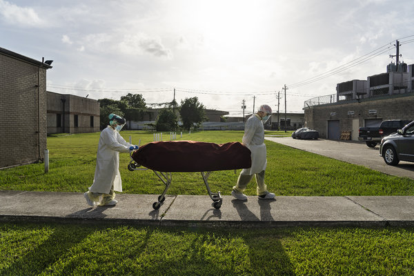 Medical personnel removed the body of a Covid-19 victim from a Houston hospital in June.