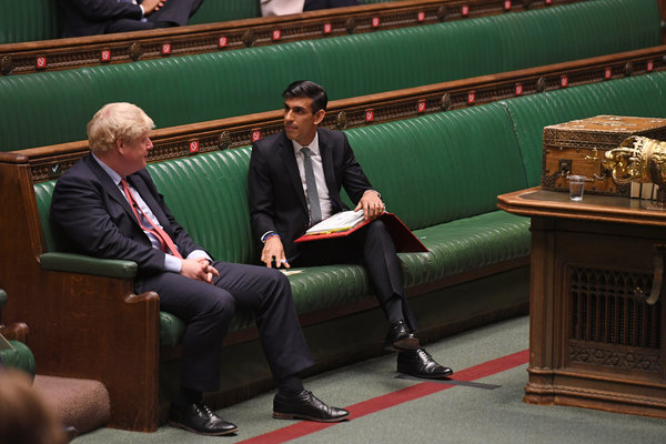 Britain's prime minister, Boris Johnson, left, and the the chancellor of the Exchequer, Rishi Sunak, at the House of Commons on Wednesday.