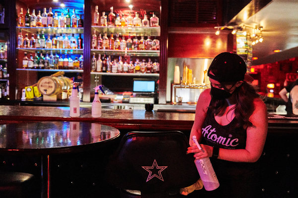 Katie Cruz, the director of operations, wiped down a special bar stool at Atomic Liquors.
