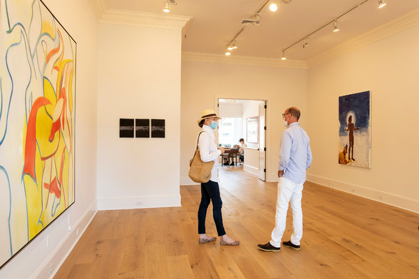 "Per Skarstedt, right, in the new Skarstedt East Hampton gallery space, which features, from left, Willem de Kooning's ""Untitled VII'' (1986); Richard Prince's ""3 Jokes Painted To Death or 3 Jokes Really Painted'' (1987); and Eric Fischl's painting, ""Like Explaining the End of the World to a Dog'' (2020)."
