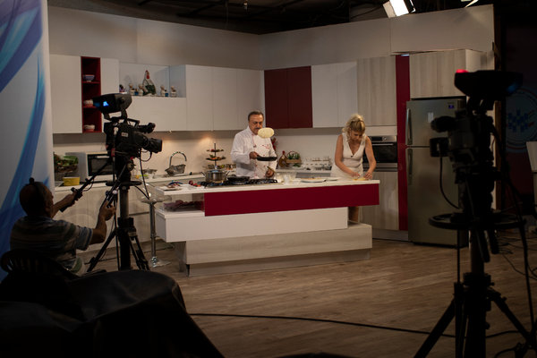 Chef Antoine El Hajj demonstrating recipes with affordable ingredients during his cooking show.