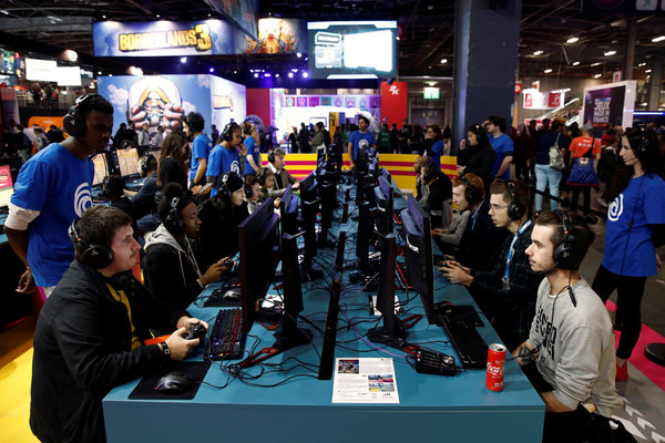 Attendees of the Paris Games Week last October playing a game from UbiSoft Entertainment. Several of the French gaming company's executives have stepped down.