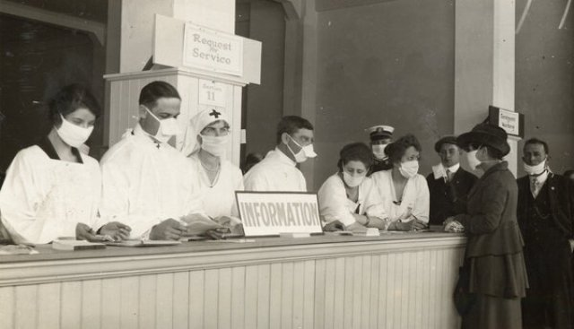 Workers at an information desk wearing masks in San Francisco in 1918.