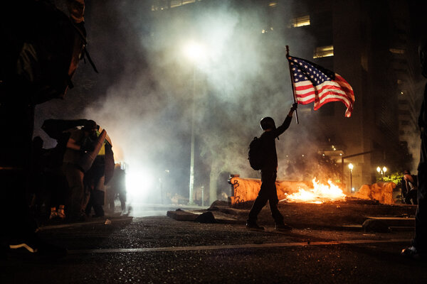 Federal agents continued their clash with protesters in Portland, Ore., early Tuesday morning.