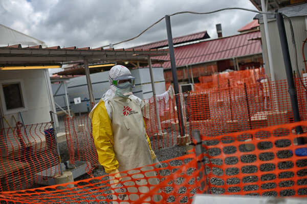 A health worker inside an Ebola treatment center in Conakry, Guinea, in 2015.