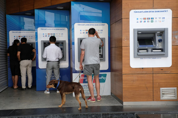 People withdraw money from ATM machines along Istiklal Street, a main shopping area in central Istanbul last week.