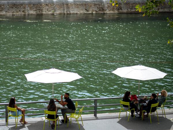 Groups along the Seine in Paris.