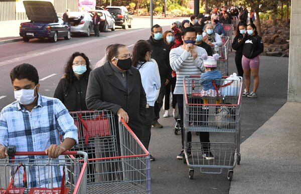 Shoppers outside a Melbourne Costco on Sunday.
