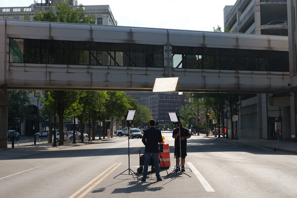 A TV crew broadcast across the street from the Wisconsin Center in Milwaukee on Monday.
