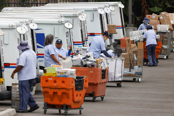 Postal workers loading trucks in Carlsbad, Calif., on Monday.