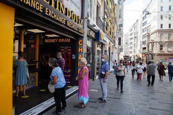 """A foreign exchange shop in Istanbul.""""Everything is unbelievably expensive,"""" one shopper said."""