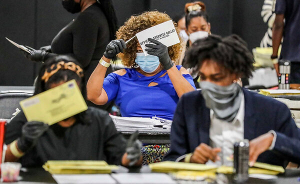 Election officials sorted absentee ballots in Atlanta last month. A district judge ordered an extension of the deadline by which absentee ballots must be received to be considered valid.