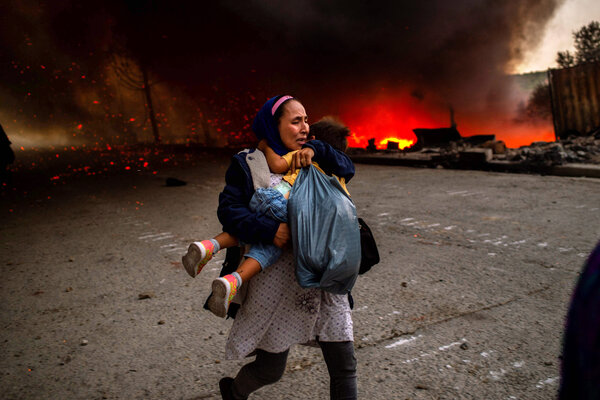 A migrant fleeing the fire in the Moria camp in Greece on Wednesday.