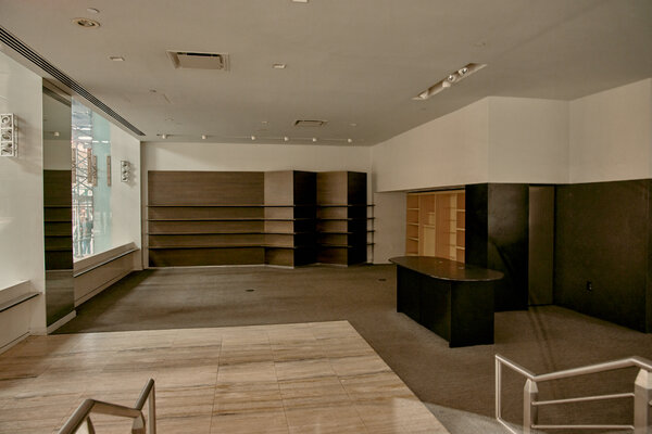 An empty retail space on Madison Avenue in New York. Economists warn that without more aid, layoffs will rise again.