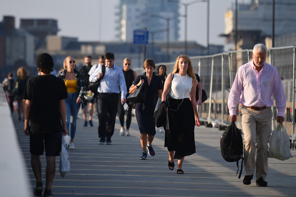 Commuters walking across London Bridge toward the City of London on Tuesday. Britain's unemployment rate rose above 4 percent for the May-July period.