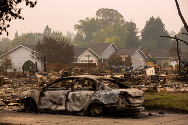 A partly burned neighborhood in Phoenix, Ore., on Monday. The climate change debate reflects the critical difference in the value the two candidates place on science-based data.