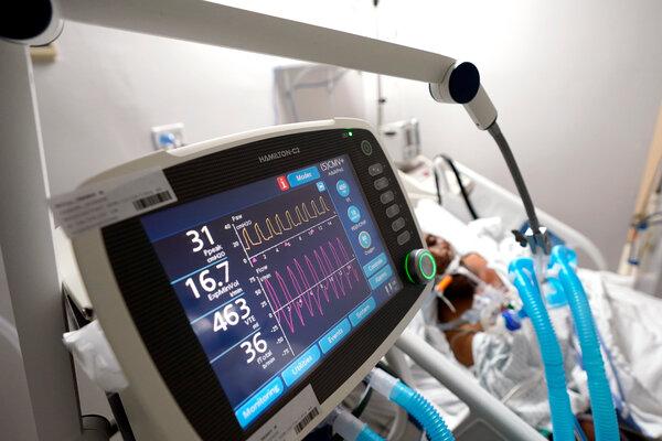 A ventilator helps a Covid-19 patient breathe inside the coronavirus unit in a Houston hospital in July.