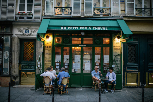 A cafe in Paris in August. France is seeing a new surge in coronavirus cases.