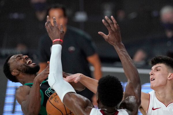 Kemba Walker lost control of the ball against the defense of Bam Adebayo, center, and Tyler Herro.